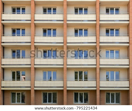 Facade of a house residential building windows with white wooden frame.