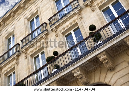 Facade of a mansion in Bordeaux, France - stock photo