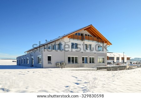 Facade of a modern commercial building shortly after its completion in winter - stock photo