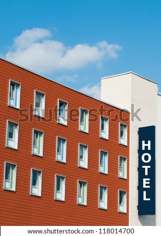 facade of a modern red brick Hotel building with sign - stock photo