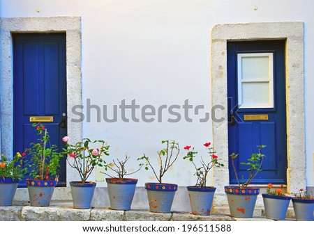 Facade of a portuguese house in Obidos - stock photo