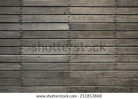 Facade of a timber stripe deck for textural background.  - stock photo