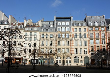 Facade of a traditional apartmemt building in Paris, France - stock photo