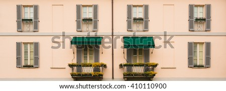 Facade of a typical residential apartment in Italy - stock photo