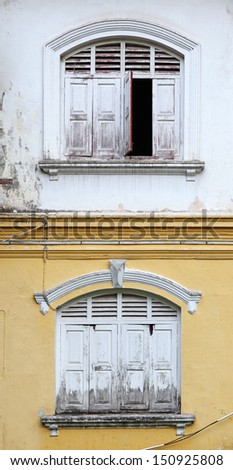 Facade of a vintage colonial building with window.  - stock photo