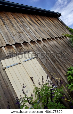 Facade of a wooden chalet and closed shutters