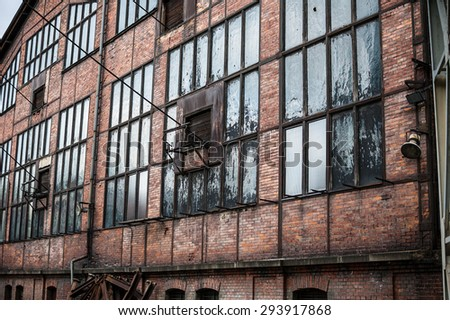 Facade of abandonded factory building.