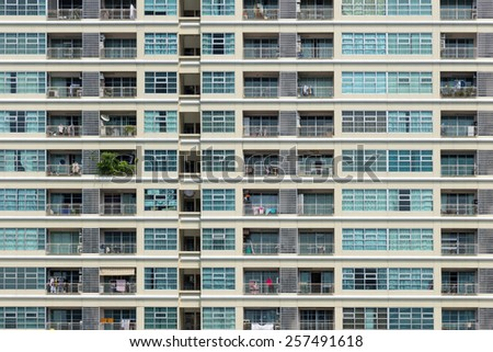 Facade of an apartment building in Bangkok, Thailand in daylight - stock photo