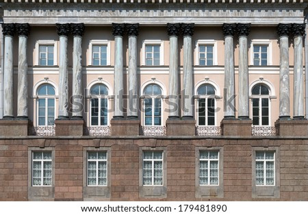 facade of an old building with columns - stock photo