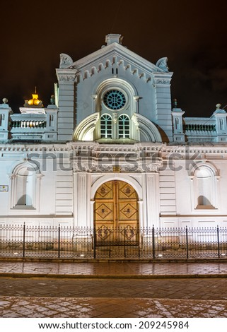 Facade of an old colonial church in Cuenca, Ecuador, at nightime - stock photo