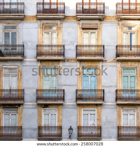 Facade of apartment buildings in Valencia, Spain, Europe, with old weathered walls of houses in the old town giving impression of this mediterranean city - stock photo