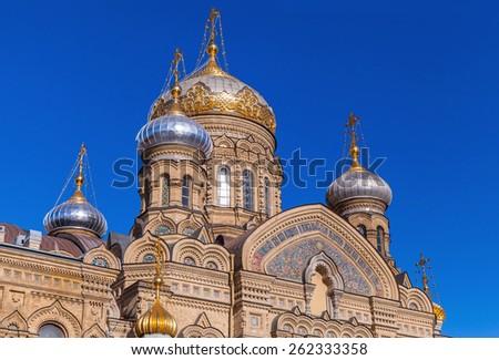 Facade of Assumption Church on Vasilevsky Island. Orthodox church in Saint-Petersburg, Russia - stock photo
