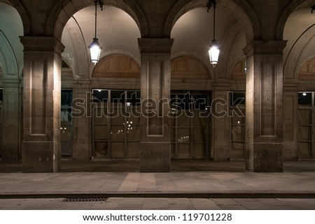 Facade of building with columns and lanterns - stock photo