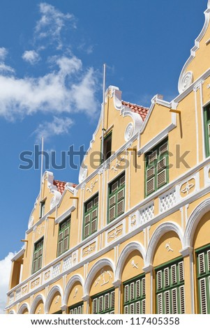 Facade of Caribbean Dutch Colonial Building. Photograph of the facade of the famous Penha department store in Willemstad, Punda, Curacao, Netherlands Antilles. - stock photo