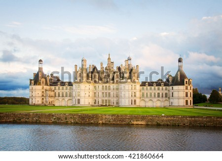 facade of Chambord chateau at sunset, Pays-de-la-Loire, France, retro toned - stock photo