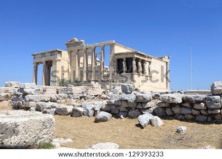 Facade of Erechtheum ancient temple at acropolis of Athens in summer, Greece