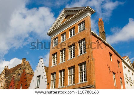 Facade of flemish houses and canal in Brugge, Belgium - stock photo