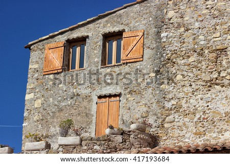 Facade of French House with Door and Windows in Roquebrune-Cap-Martin, France - stock photo