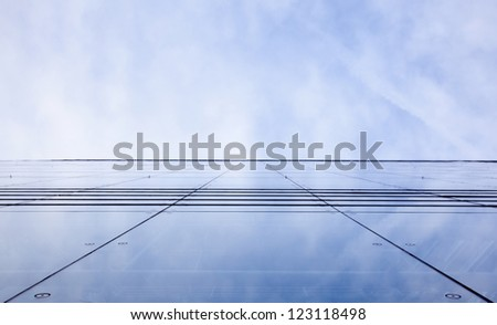 facade of glass and reflection of sky and clouds - stock photo