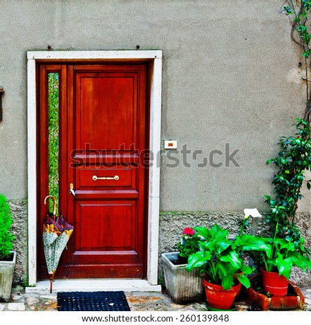 Facade of Italian House Decorated with Fresh Flower - stock photo