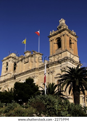 Facade of medieval church in Malta - stock photo