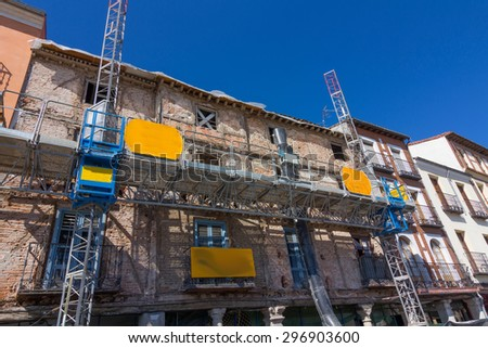 facade of old building in remodeling, retaining outside - stock photo