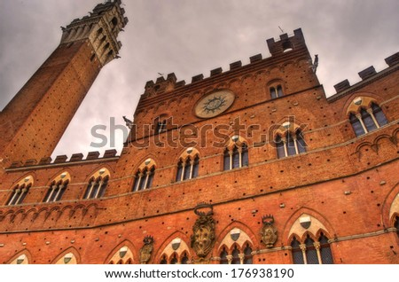 Facade of Palazzo Pubblico and Mangia Tower, Siena, Tuscany, Italy