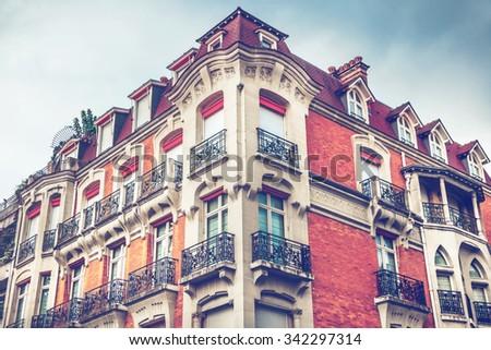Facade of Parisian building - stock photo