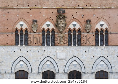 Facade of Piazza del Campo in the historic center of Siena, Tuscany, Italy - stock photo