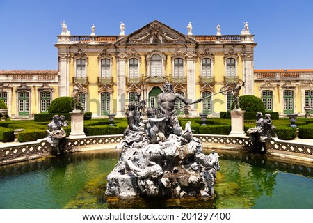 Facade of Queluz National Palace, and Neptune fountain in Sintra, Lisbon district, Portugal - stock photo