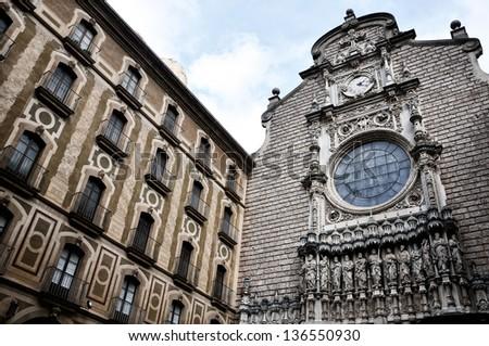 Facade of Santa Maria de Montserrat Monastery in Catalonia, Spain. - stock photo