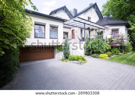 Facade of spacious mansion in luxury style - stock photo