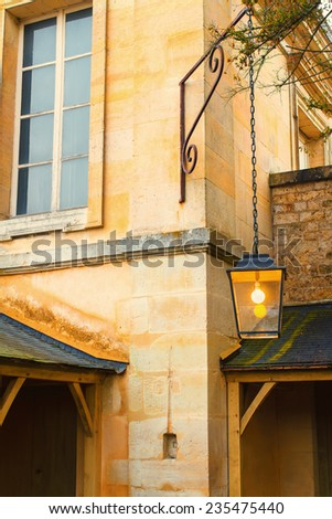 Facade of 18th century French building with street lamp