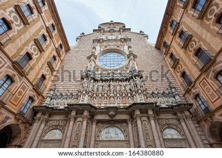 facade of the basilica at the Benedictine Abbey at Montserrat, Santa Maria de Montserrat, near Barcelona, Catalonia, Spain - stock photo