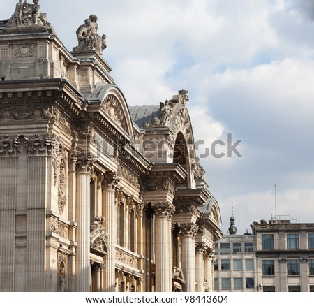 Facade of the Bourse in Brussels with the carved entrance arch - stock photo