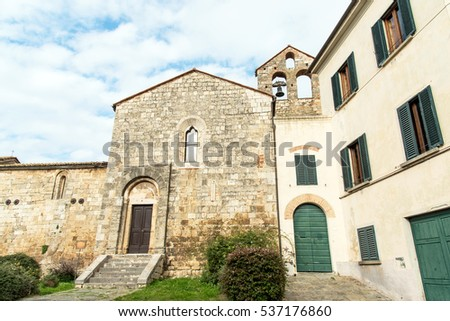 facade of the church of Saint Martin, built in the 11th century, in Magliano in tuscany, italy