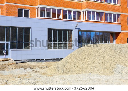 facade of the new building under construction - stock photo