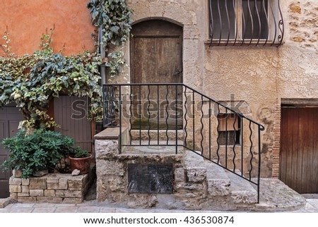 Facade of the old house in medieval village France - stock photo