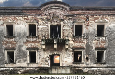Facade of the ruins of a big abandoned castle in Transylvania - stock photo