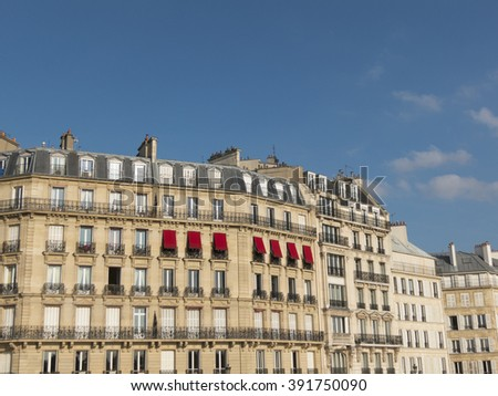 Facade of traditional apartment buildings in Paris, France