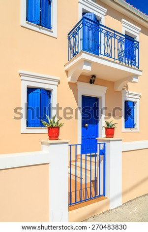 Facade of typical Greek house built in Venetian style in Assos town, Kefalonia island, Greece - stock photo