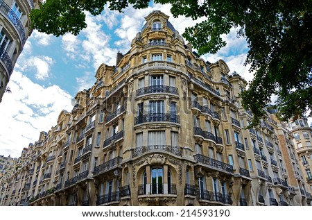 Facade of typical house with balcony in Paris. City, urban view on building in Paris, France - stock photo