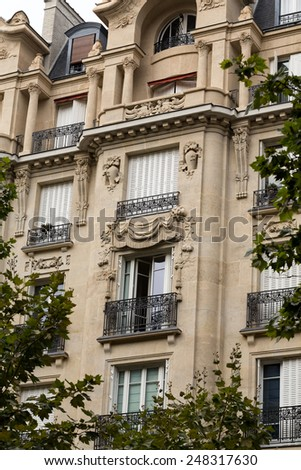 facade of typical house with balcony in Paris, France  - stock photo