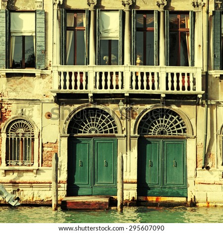 Facade of typical medieval house on Grand canal, Venice, Italy. Square vintage toned image, instagram effect - stock photo