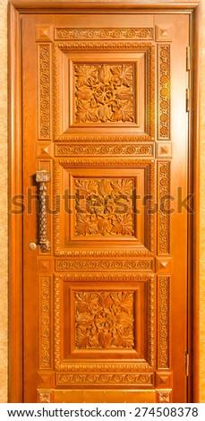 Facade of wooden door - stock photo