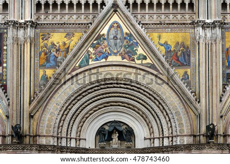 Facade site of the Duomo Cathedral portal  with Statue Mary (Saint Mary or Virgin Mary) and the Jesus, Orvieto, Umbria, Italy