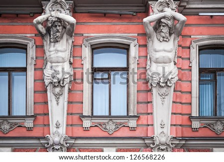 Facade with men statues of an old palace in St.Petersburg, Russia. Belosselsky-Belozersky Palace is Neo-Baroque style was built in 1847-48 by project of Andrei Ivanovich Stakenschneider