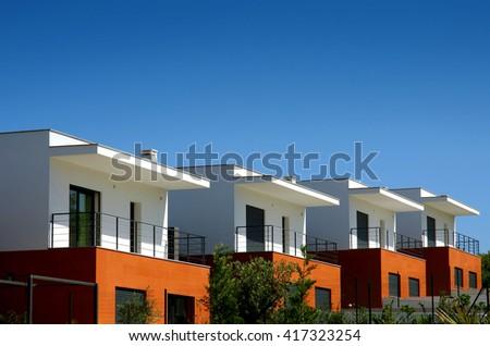 Facades of a modern houses condominium in a sunny day - stock photo