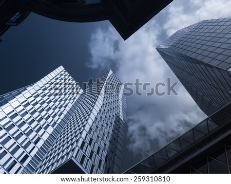 Facades of dynamic skyscrapers in Frankfurt, Germany - stock photo