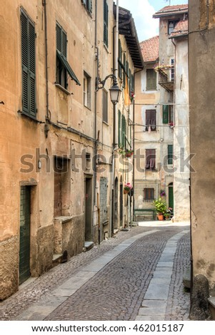 Facades of houses in a small street in the small mountain village Sassello in the north of Italy